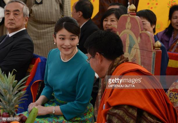 Japanese Princess Mako speaks with Bhutanese Minister of Foreign affairs Lyonpo Damcho Dorji ahead of the opening ceremony for 'Japan Week' at the...