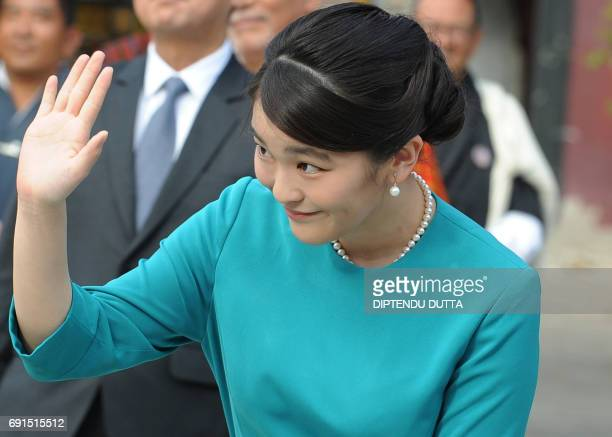 Japanese Princess Mako waves to Bhutanese wellwishers ahead of the opening ceremony for 'Japan Week' at the Clock Tower in Thimpu on June 2 2017...