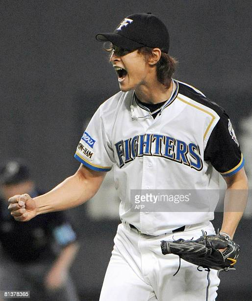 Japanese professional baseball team Hokkaido Nippon Ham Fighters pitcher Darvish Yu celebrates his win against the Softbank Hawks at the Sapporo Dome...