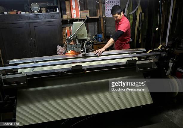 Japanese professional Tatami mat manufacturer Mitsuru Yokoyama makes Tatami at Motoyama Tatami Shop on October 18 2013 in Kyoto Japan Tatami mat is a...