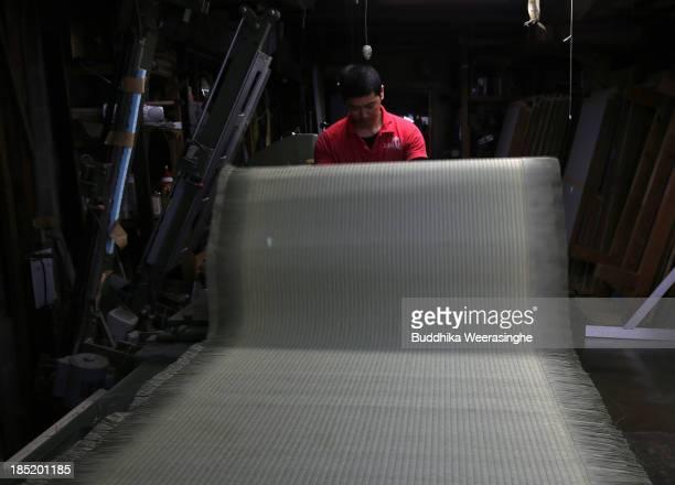 Japanese professional Tatami mat manufacturer Mitsuru Yokoyama makes a Tatami at Motoyama Tatami Shop on October 18 2013 in Kyoto Japan Tatami mat is...