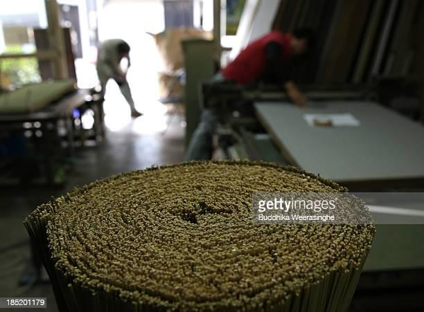 Japanese professional Tatami mat manufacturers make Tatami at Motoyama Tatami Shop on October 18 2013 in Kyoto Japan Tatami mat is a type of flooring...