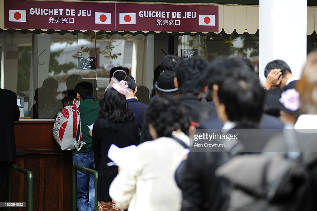 Japanese queue at the betting windows at Longchamp racecourse on October 06, 2013 in Paris, France.