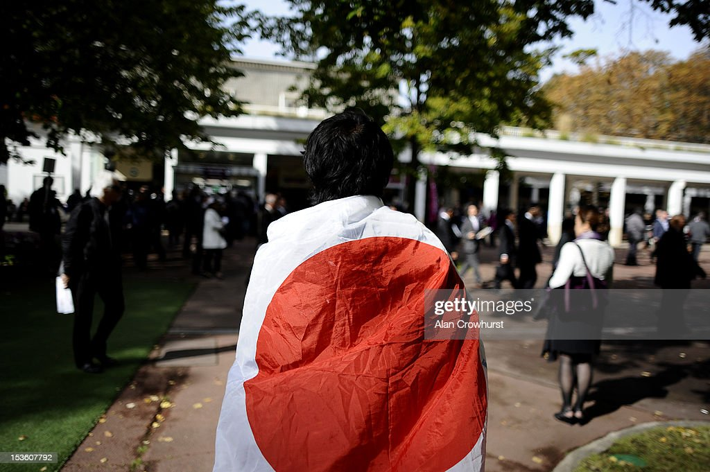 A Japanese racegoer wears his countrys flag at Longchamp racecourse on October 07, 2012 in Paris, France.