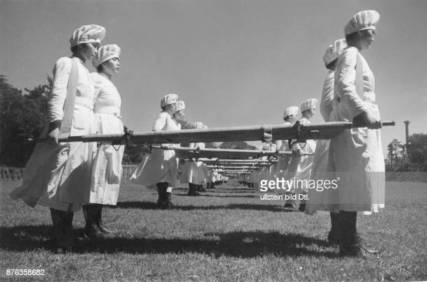 Japanese Red Cross Society nurses practising how to carry the stretcher DomonKen Vintage property of Ullstein Bild