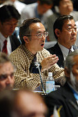 A Japanese representative comments during the 54th annual meeting of the International Whaling Commission at the Kaikyo Messe on May 24 2002 in...