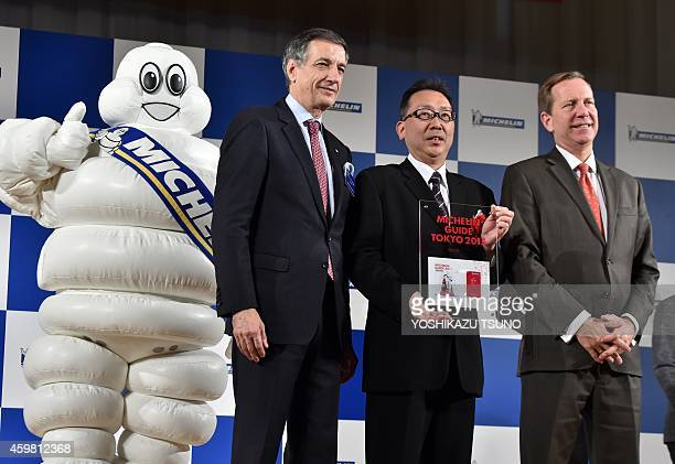 Japanese restaurant Esaki chef Shintaro Esaki receives a trophy as he was selected as the new threestar chef by the new Michelin Guide Tokyo 2015...