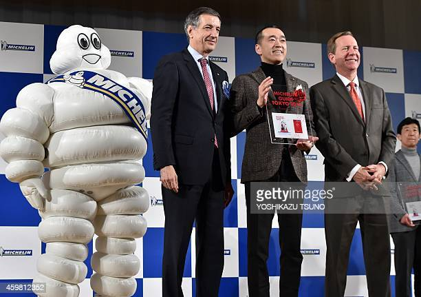 Japanese restaurant Ishikawa chef Hideki Ishikawa receives a trophy as he was selected as the new threestar chef by the new Michelin Guide Tokyo 2015...