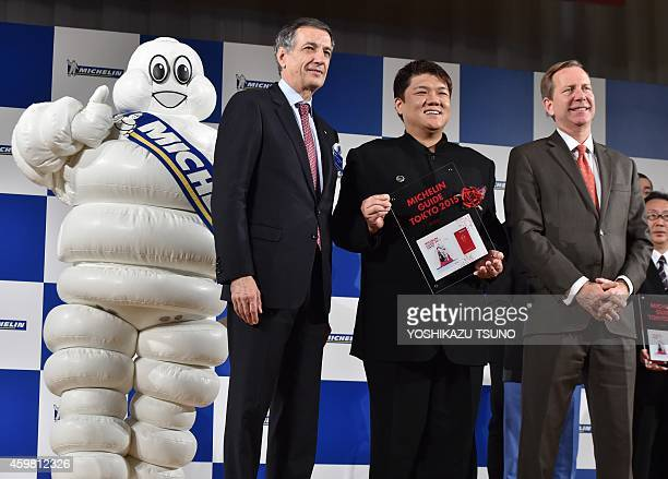 Japanese restaurant Ryugin chef Seiji Yamamoto receives a trophy as he was selected as the new threestar chef by the new Michelin Guide Tokyo 2015...