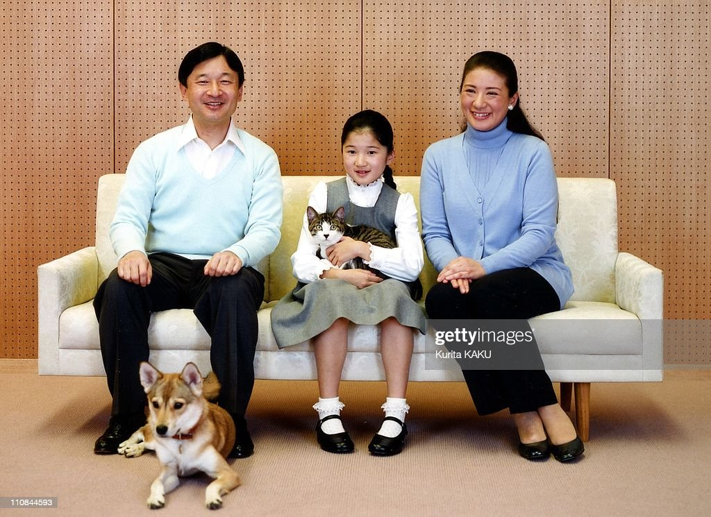 Japanese Royal Photo Session In Tokyo, Japan On December 02, 2010 - In this photo taken on Thursday, December 2, 2010 and released by the Imperial Household Agency of Japan, <a gi-track='captionPersonalityLinkClicked' href=/galleries/search?phrase=Crown+Prince+Naruhito&family=editorial&specificpeople=158365 ng-click='$event.stopPropagation()'>Crown Prince Naruhito</a>, left, and <a gi-track='captionPersonalityLinkClicked' href=/galleries/search?phrase=Crown+Princess+Masako&family=editorial&specificpeople=580174 ng-click='$event.stopPropagation()'>Crown Princess Masako</a>, right, smile as they look on their daughter Princess Aiko holding her cat reacts with her dog Yuri during their photo session at their residence Togu Palace in Tokyo - Masako turns 47th birthday Thursday, December 9, 2010.