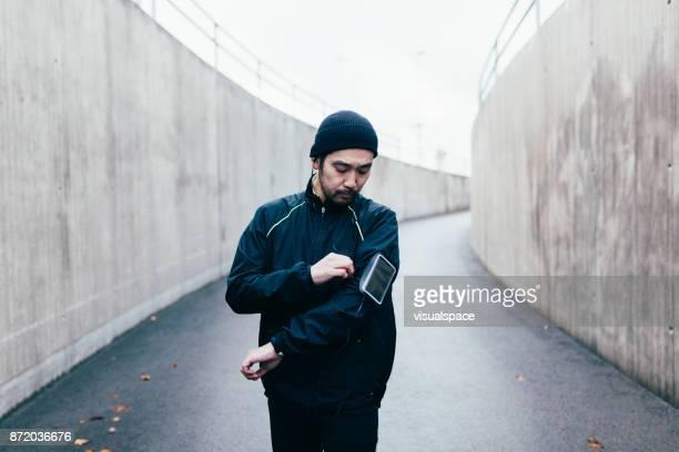 Japanese runner adjusts armband