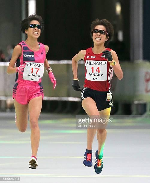 Japanese runners Tomomi Tanaka and Rei Obara run to the finish line in the Nagoya Women's Marathon on March 13 2016 / AFP / JIJI PRESS / JIJI PRESS /...