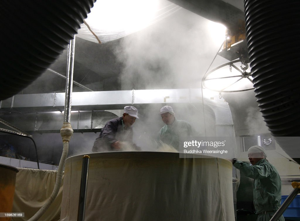 Japanese sake brewery workers shovel out 1000 kilos of freshly steamed rice in preparation for making sake at Tatsuriki sake brewery on January 21, 2013 in Himeji, Japan. The Hyogo prefecture is the largest sake producing region in Japan.