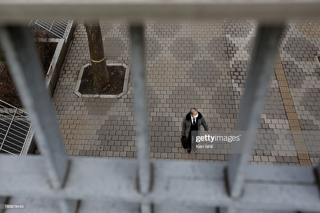 A Japanese 'Salary man', or office worker is seen on February 7, 2013 in Tokyo, Japan. A recent servey shows Tokyo as the most expensive city in the world and Osaka ranked second.