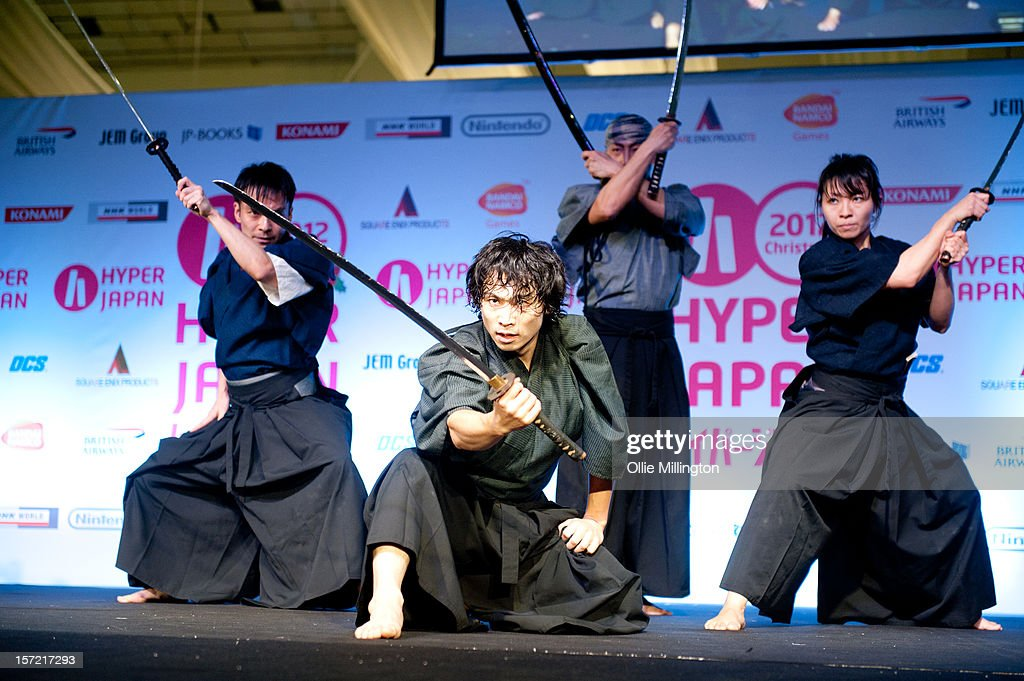 Japanese Samurai sword fighting performance troop Kamui Japanese Samurai sword fighting performance troop Kamui performing during the Hyper Japan event. Founded by Tetsuro Shimaguchi, Hiroaki Kawaguchi, and Juri Manase in 1998. Tetsuro Shimaguchi featured in Quentin Tarantinos Kill Bill: Volume 1 as an actor and choreographer. The show is the UK's largest Japanese Culture event, with trade stands selling clothing, anime, Japanese food, cult action figures, swords and a large variety of video games merchandise. Many attendees dress up as anime characters and in the lolita fashion with the weekend being a prominent UK date on the global Cosplay scene at Earls Court on November 24, 2012 in London, England.