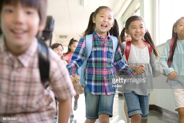 Japanese school children in corridor