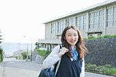 Japanese school girl on street, smiling