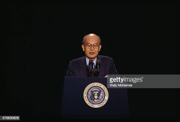 A Japanese school official at Waseda University speaks at a presidential podium set up for a speech by President Clinton during a presidential visit...