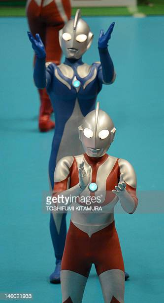 Japanese Science and Fiction charactor Ultraman performs during the men's volleyball qualifying tournament match between Japan and Puerto Rico for...