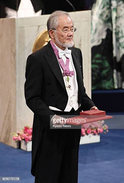 Japanese scientist Yoshinori Ohsumi receives the Nobel Prize in physiology or medicine for his research on cell recycling at an award ceremony in...