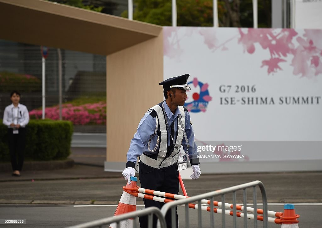 A Japanese security personell puts a security block outside the 2016 Ise-Shima G7 Summit International Media Center in Ise-Shima, 300 kilometres southwest of Tokyo on May 24, 2016. / AFP / MANAN