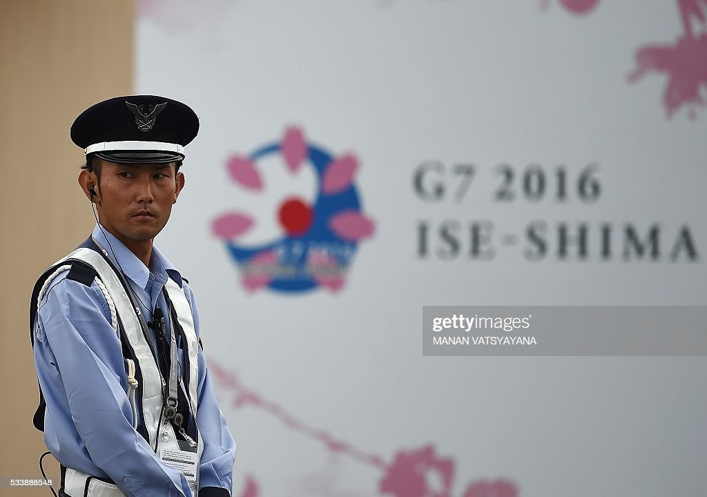 A Japanese security personell stands guard outside the 2016 Ise-Shima G7 Summit International Media Center in Ise-Shima, 300 kilometres southwest of Tokyo on May 24, 2016. The lacklustre global economy should take centre stage as world leaders gather in Japan this week, but with no agreement likely on igniting growth, Barack Obamas visit to the atomic-bombed city of Hiroshima looks set to capture the limelight. / AFP / MANAN