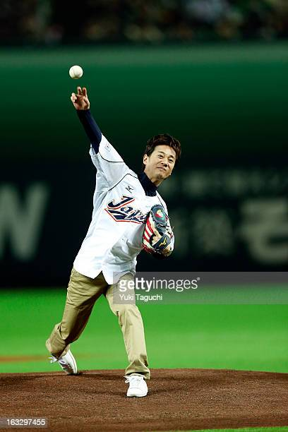 Japanese singer and actor Masahiro Nakai throws out the ceremonial first pitch before the 2013 World Baseball Classic exhibition game between Team...