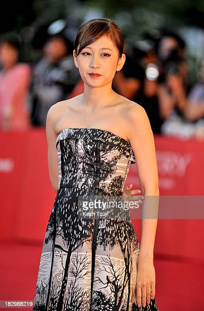Japanese singer and actress Atsuko Maeda attends the opening ceremony during the 18th Busan International Film Festival on October 3 2013 in Busan...