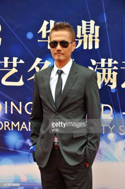 Japanese singer Atsushi of Exile arrives at the red carpet for the 2012 Huading Awards Ceremony at Beijing Olympic Sports Center on July 4 2012 in...