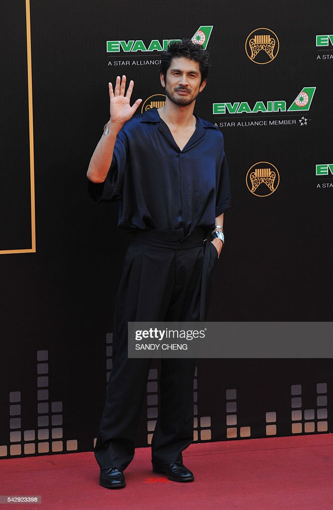 Japanese singer Ken Hirai arrives to attend the 27th Golden Melody Awards in Taipei on June 25, 2016. Some of Mandarin pop's biggest names have gathered for the annual Golden Melody music awards, with singers, songwriters and composers from Taiwan, China, Hong Kong, Singapore and Malaysia competing in more than 20 categories. / AFP / SANDY
