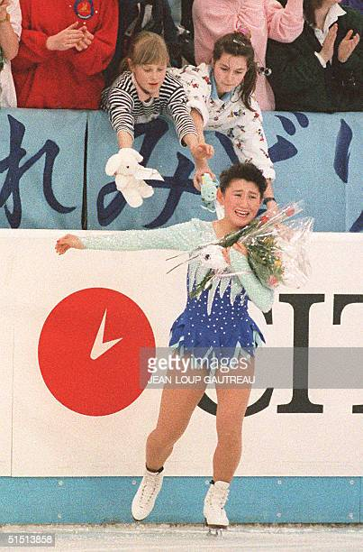 Japanese skater Midori Ito leaves the ice after receiving flowers from fans following her free program at the World Figure Skating Championships 18...