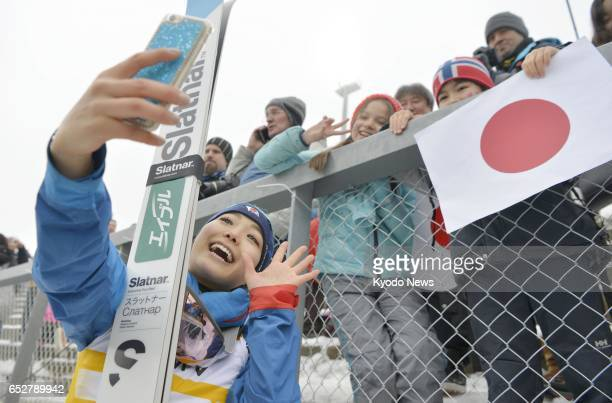 Japanese ski jumper Sara Takanashi poses for a selfie with children in Oslo Norway on March 12 after finishing first in the World Cup overall...