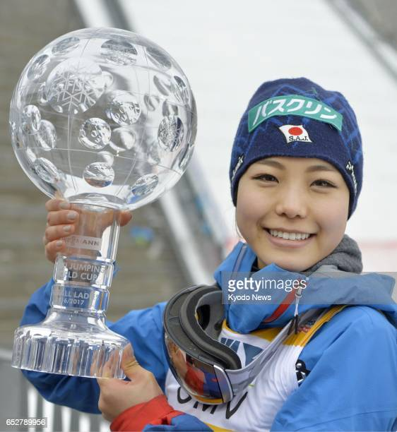Japanese ski jumper Sara Takanashi poses with a trophy in Oslo Norway on March 12 after finishing first in the World Cup overall rankings ==Kyodo