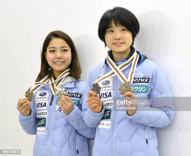 Japanese ski jumpers Sara Takanashi and Yuki Ito show off their medals at Narita airport near Tokyo on Feb 28 after returning from Finland where they...