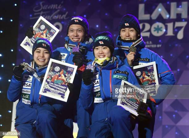Japanese ski jumpers Sara Takanashi Taku Takeuchi Yuki Ito and Daiki Ito show off their bronze medals after the mixed team event on the normal hill...