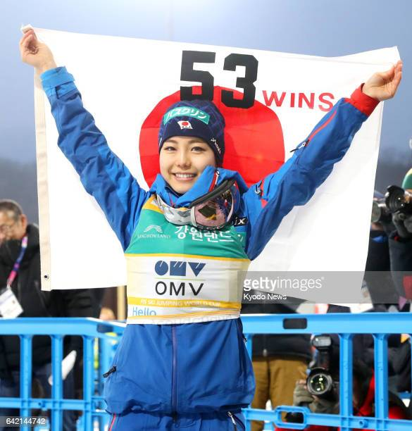 Japanese ski jumping superstar Sara Takanashi poses with the Japanese flag after capturing the 53rd World Cup title of her career to tie Austrian...