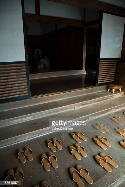 Japanese Slippers carefully placed for guests on arrival at Ekoin Temple's 'engawa' or entrance in Koyasan Visitors to Japanese homes and temples are...