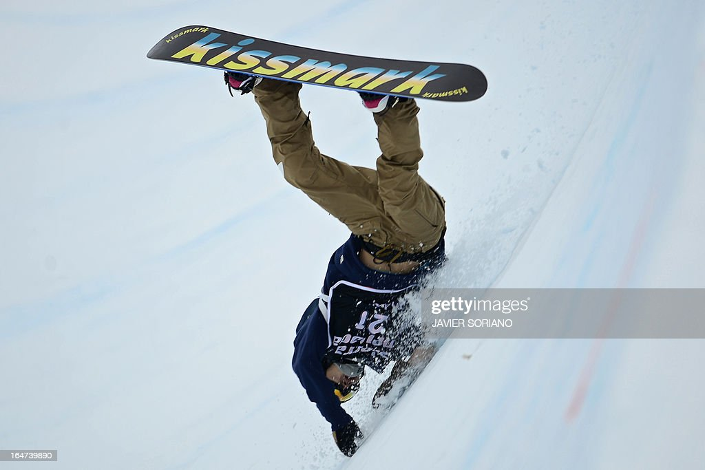 Japanese snowboarder Kosuke Hosokawa falls during the Men's Half-Pipe final race at the Snowboard and FreeStyle World Cup Super finals at Sierra Nevada ski resort near Granada on March 27, 2013.