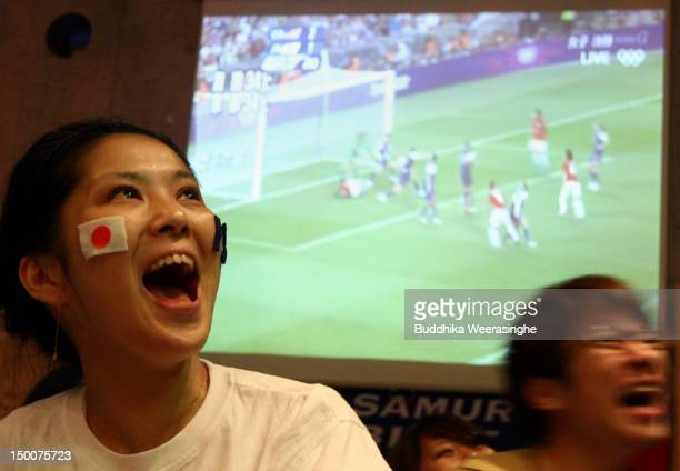 Japanese soccer fans react during the women's Olympic final soccer match between Japan and the US at Sporterea Sport pub on August 10 2012 in Kobe...