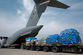 Yokota Air Base, Japan, March 20, 2011 - Pallets of water, food and blankets being loaded onto a C-17 Globemaster III aircraft. These were the first humanitarian relief supplies to be delivered to Sen