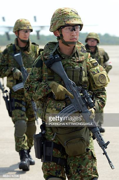 Japanese soldiers stand guard during a NonCombatant Evacuation/Transportation of Japanese Nationals Overseas exercise as part of the annual combined...