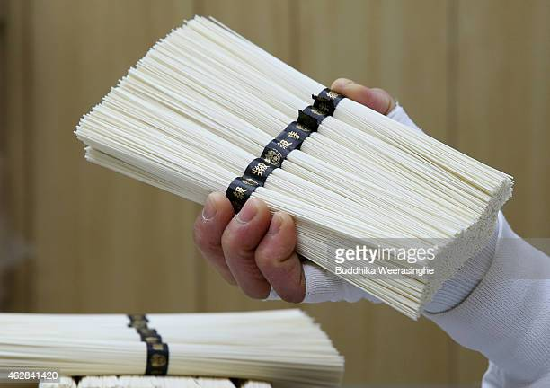 Japanese somen maker makes 50g bundles of Ibonoito somen noodles on the production line on February 6 2015 in Tatsuno Japan Somen is a type of...