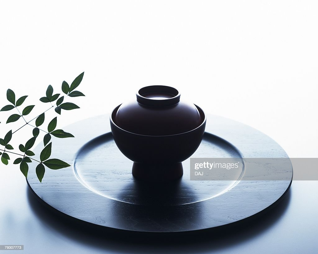 A Japanese soup bowl with lid on a plate, Close Up, High Angle View