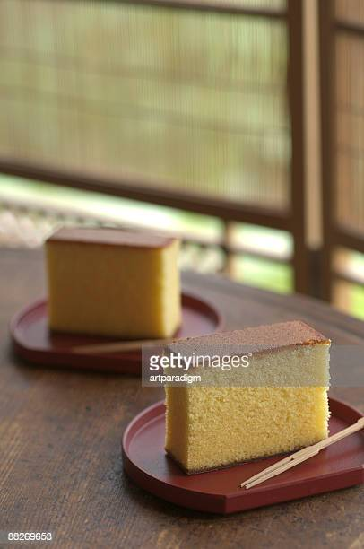 Japanese sponge cakes on wooden round table