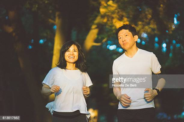Japanese Sport Couple Exercising Outdoors In The Early Morning