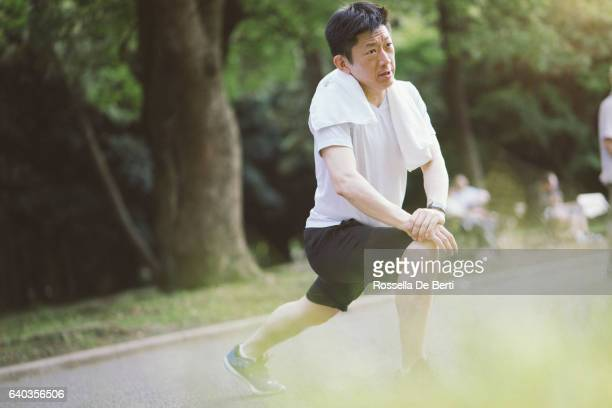 Japanese Sport Man Exercising Outdoors In The Early Morning