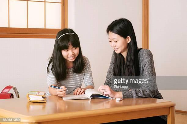 Japanische Student mit Tutor