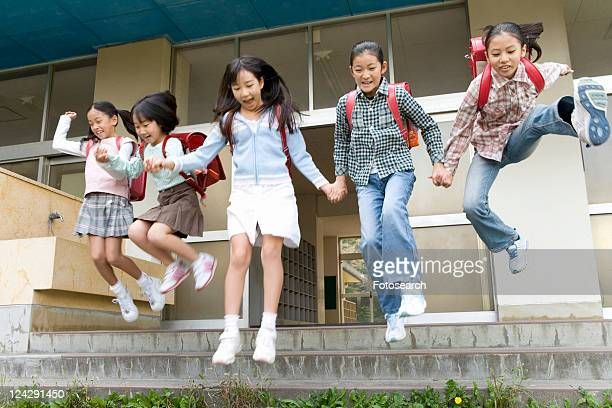 Japanese Students Jumping Over Steps