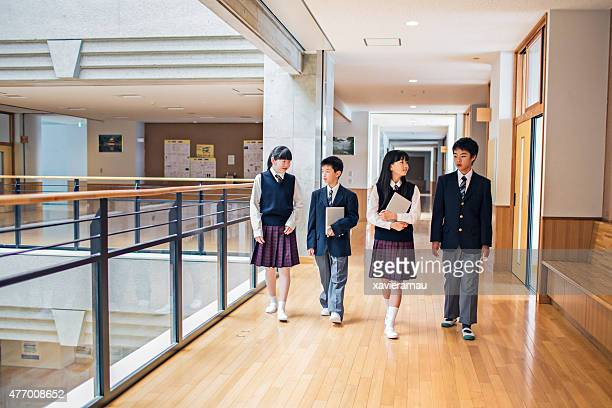Japanese students walking in the school corridors