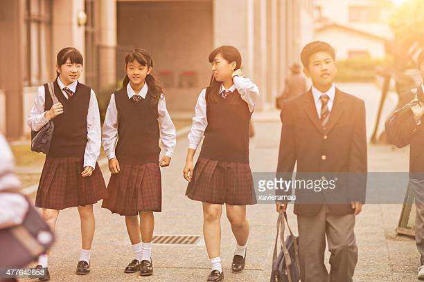 Japanese students walking outside the school yard